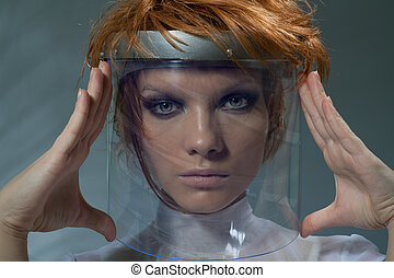 Serious clever woman in glass mask staring at camera