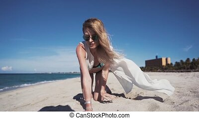 Girl, beach, sea, wind in your hair A beautiful girl in a...