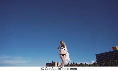 Girl, beach, sea, wind in your hair. girl in color bikini...