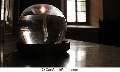 Oil lamp in a dark room - Oil lamp burning with a soft glow...