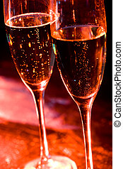 Flutes with champagne - Close-up of two flutes of champagne...
