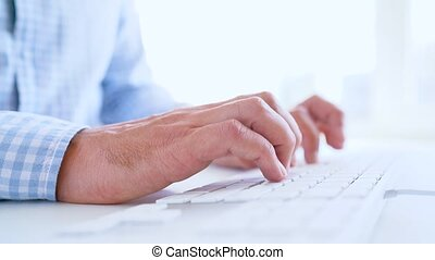 Man office worker typing on the keyboard - Hands or man...