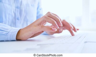 Woman office worker typing on the keyboard - Hands or woman...