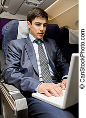 Computer work - Image of busy male typing on laptop during...