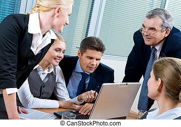 Explaining idea - Portrait of confident co-workers looking...