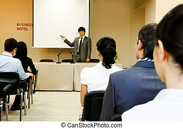 At conference - Image of confident businessman explaining...