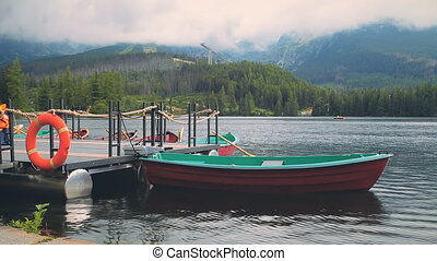 Boat on the Mountain lake in High Tatras, Slovakia - Boat on...