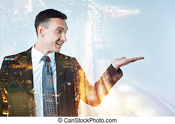 Cheerful businessman showing perspectives of his company -...