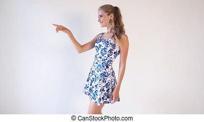 girl in colored dress posing shows the direction of 1