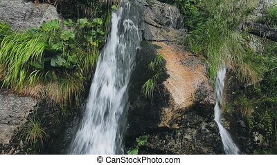 Powerful mountain cascade waterfall in the forest -...
