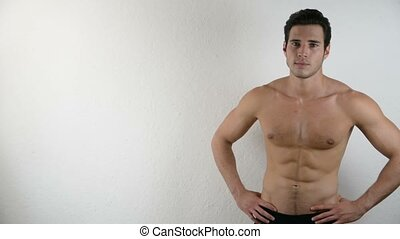 Handsome shirtless athletic young man on white - Handsome...