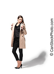 woman in trench coat - charming fashionable woman posing in...