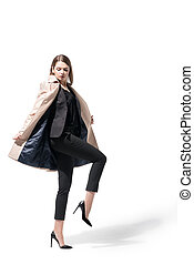 girl in suit and trench coat - stylish beautiful girl posing...