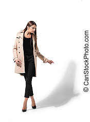 woman in trench coat - attractive fashionable woman posing...