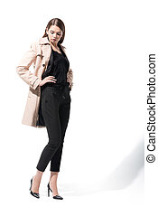 lady in trench coat - elegant lady standing in classic...