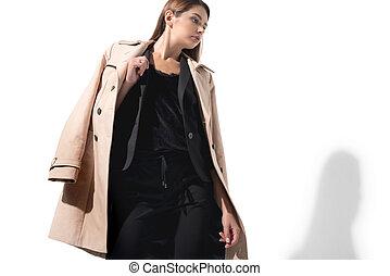 woman in trench coat - beautiful elegant woman posing in...
