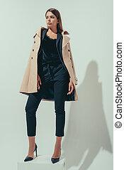 girl in trench coat - elegant girl posing in black suit and...