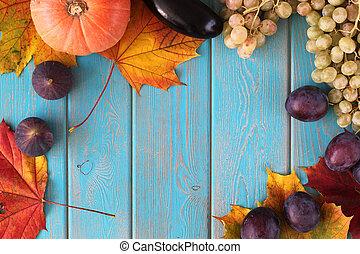 Composition of vegetables on blue wooden desk. Pumpkin,...