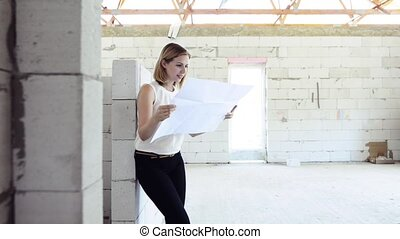Young woman at the construction site.
