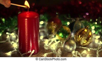 Burning Christmas candle - Burning candle on Christmas tree.
