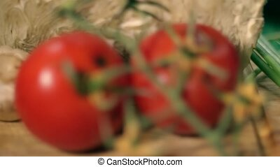 Rotten Tomatoes on Wooden Background focusing - Rotten...