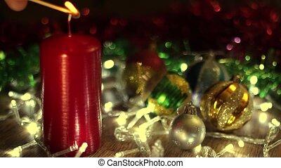 Burning Christmas candle with Christma lights - Burning...