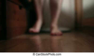 Male feet getting out of bed and walk - Male feet getting...