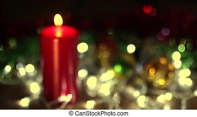 Burning Christmas candle focusing - Burning candle on...