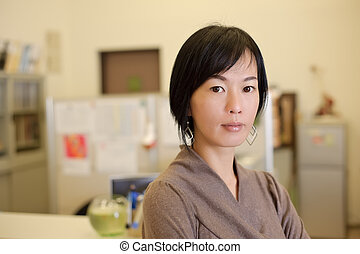 Asian business woman in office, closeup portrait