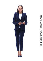 confident business woman walking forward - in full growth....