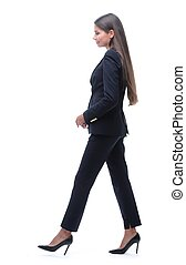 side view.young business woman walking forward .isolated on...