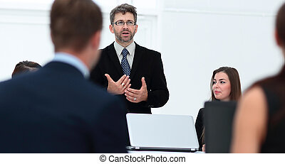senior Manager makes a report at the briefing. - closeup of...