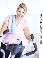 Gym and Fitness - Gym Fitness Smiling elderly woman working...
