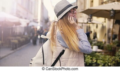 Girl Walks backward with Phone and Coffee - Joyful caucasian...