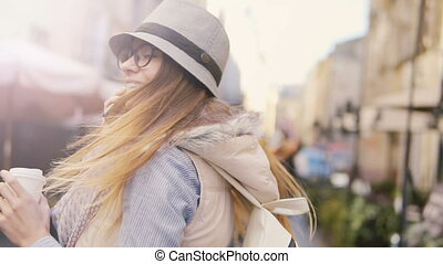 Smiling Girl Walks with Phone and Coffee - Intelligent...