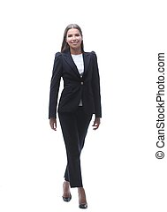 young business woman walking forward. - in full growth....