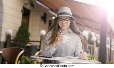 Girl Having Morning Coffee with Tablet - Smart caucasian...
