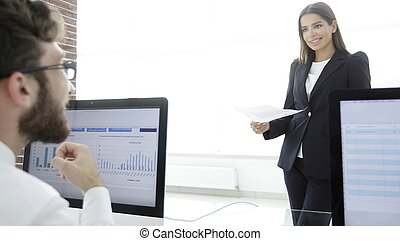business colleagues working with financial documents in the...