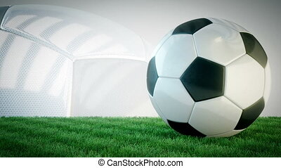 Rotating glossy soccer ball on grass field - seamless loop