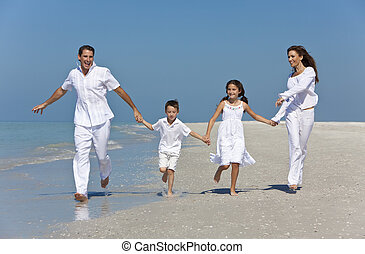 Mother, Father and Children Family Running Having Fun At Beach