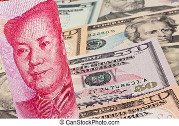 Yuan and Dollar - Chinese Yuan banknotes and U.S. dollars...
