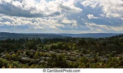 Panning video of clouds and sky over residential homes in...