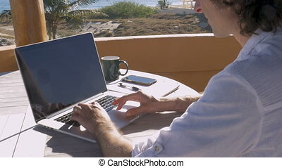Self employed entrepreneur man working on laptop from home...