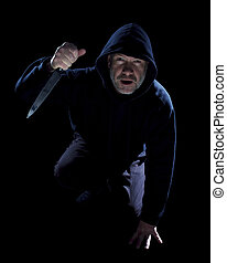 Surprised Burglar - Crouching burglar with kitchen knife on...