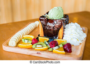 Honey toast and whipping cream with chocolate sauce, fruit...