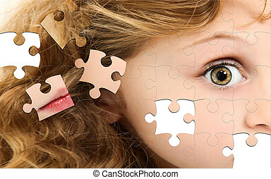 Puzzle Girl Face - Close up of profile child puzzle pieces...