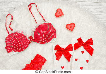 Fashion concept. Red bra and white stockings with bows,...