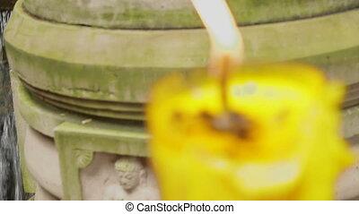 High large yellow candle burns. Wat Saket, Bangkok,...
