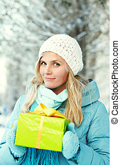 woman with gift box - Pretty woman with a gift box in her...