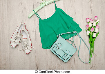 Green top, white sneakers, mint bag and a bouquet of tulips....